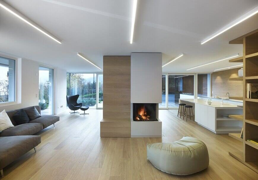 On a standard ceiling, you can add some visual interest with a lighting element. This room uses long and think lighting elements to give the ceiling a direction and some appeal