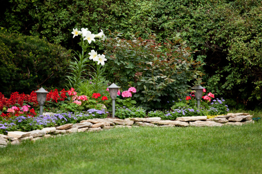 Adding lighting elements to your flower bed lets people see your lively flowers at night, letting their color brighten up your yard even at night. It also lets people know where the flowers are, so people know where not to step. The right lighting elements look quite good in the daytime as well.