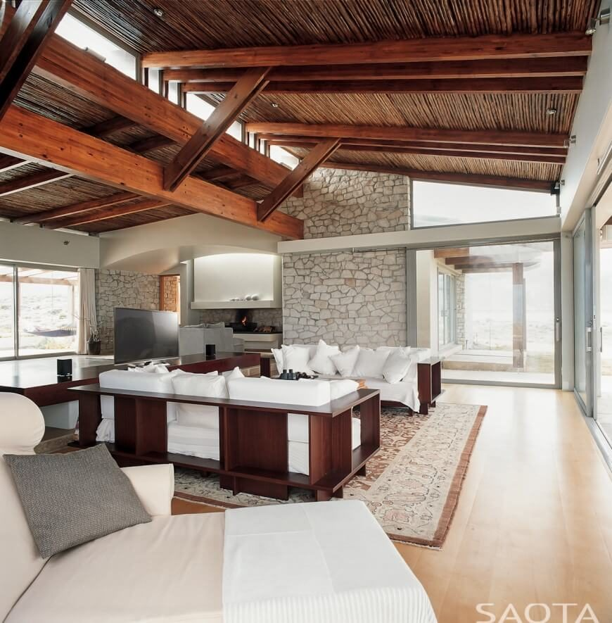 In This Modern And Simple Living Room, The Exposed Beam Ceilings, Along  With The