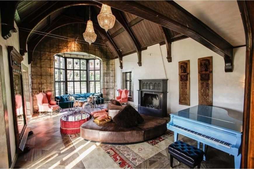 Here is a living room with high vaulted ceilings that give this area an  almost castle