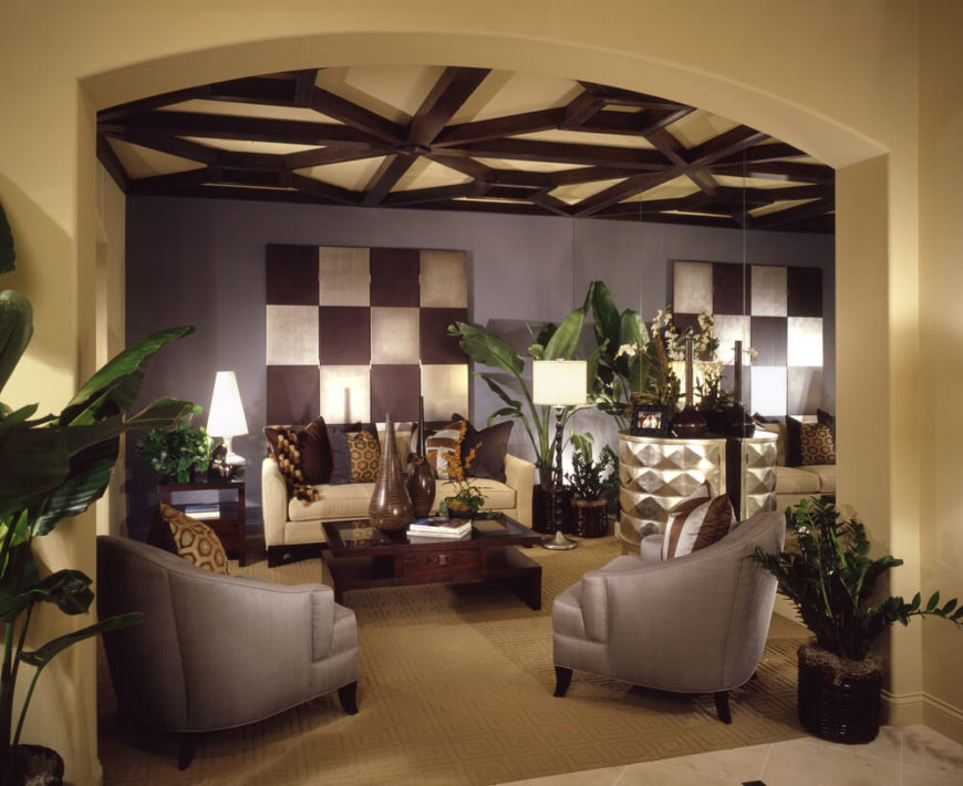 Here is an interesting coffered ceiling with different shaped sections, creating a pattern. With a coffered ceiling, coloring the beams and the recessed areas different colors can add some contrast and depth to your space.