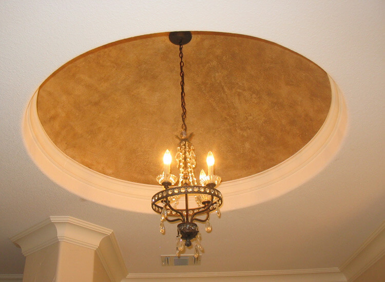 A dome is a great place to hang a chandelier. In this picture, a dome holds a low hanging lighting fixture. A dome can make a room seem larger and more spacious.