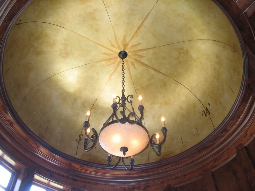 A bit of art on the inside of a dome is a great idea. This done decorated with a compass rose, with a rich sepia tone, giving this dome am antique and vintage look.