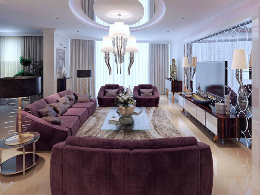 This living room has a small and elegant dome, with a chandelier hanging down out of it. A dome provides a place for lighting elements to hang, and can reflect the light that shines up back down.