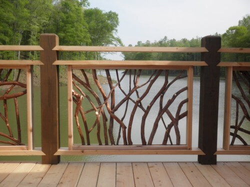 This custom railing has a clean frame with hefty posts, but the panels are created with natural branches. Each panel is utterly unique.