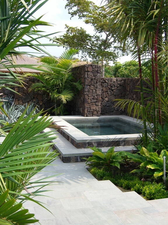 Surrounding your hot tub with greenery is an amazing way to make it feel even more secluded. You can really escape into this hot tub and forget the rest of the world.
