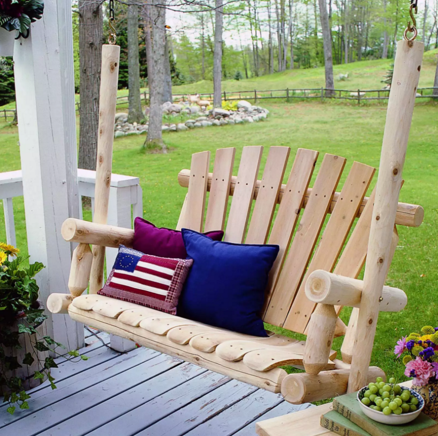 Here is a simple, natural log and unfinished wood porch swing on a porch. The railing on the porch behind the swing is missing so that the swing does not collide with the railing. It is important to know the range of your swing and make sure anything it may collide with is moved a safe distance away.