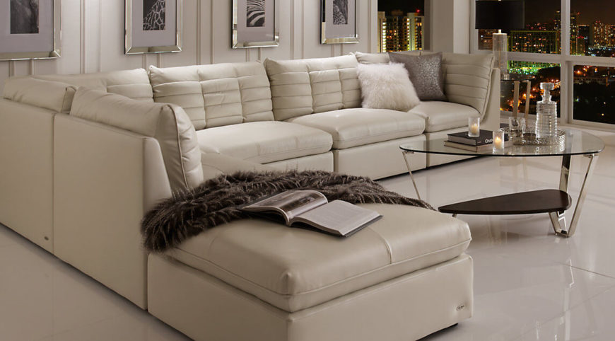 Here We See A Simple White Sectional Sofa With A Chaise Lounge. Even Though  The