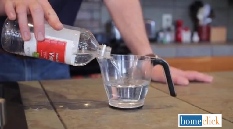 In your measuring cup, mix one full cup of vinegar and one cup of hot water together. It doesn't need to be boiling, just hot. Pour this mix down the drain and then cover the drain with a drain plug. It's important to let this sit for 10 solid minutes. This is where the drain clearing magic happens.