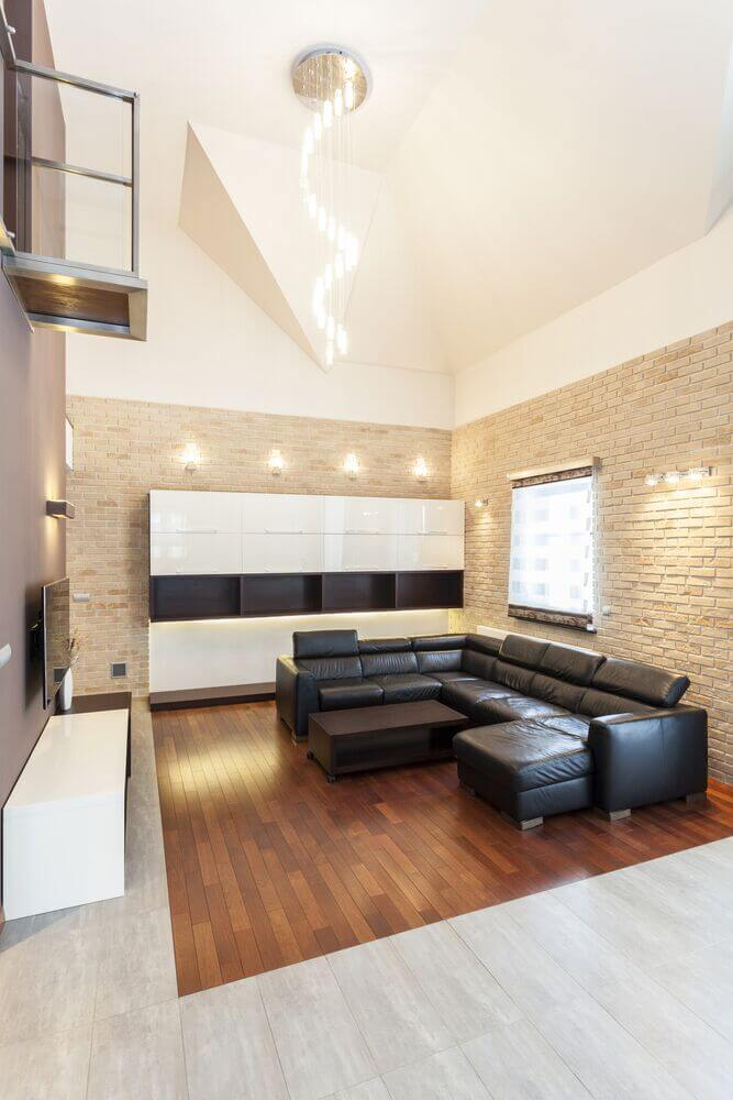 A vaulted ceiling can make a room seem much bigger. It gives a massive sense of space. This can really help small spaces feel larger as well as making simple designs feel even more open and uncluttered.
