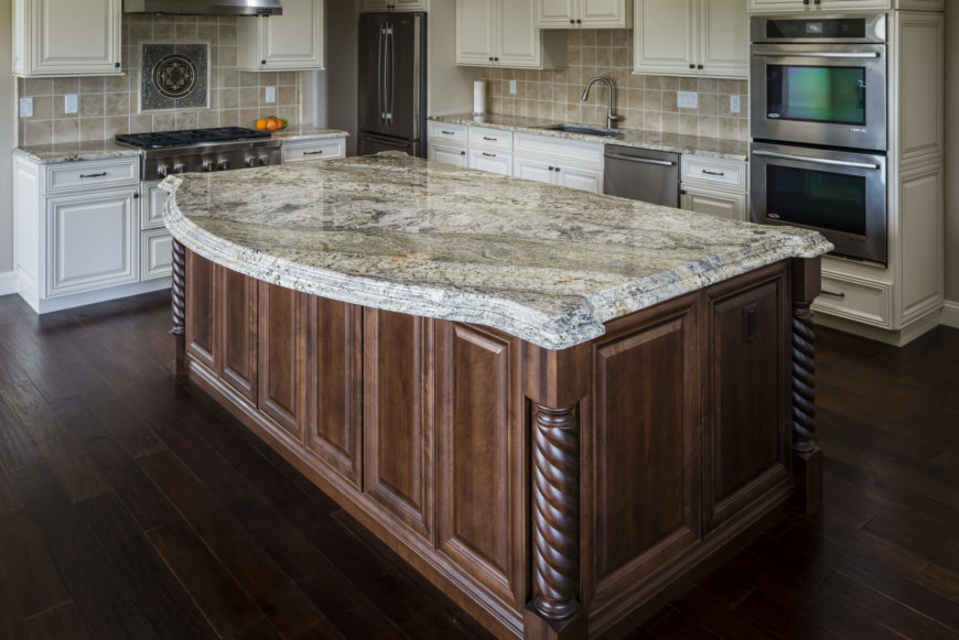 Another look at the above granite. Note the intricate details on the island, which is a different color than the main set of cabinetry.