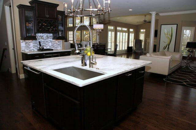 White granite with several long veins is another classic look. When paired with a much more showy gray and white mosaic tile backsplash, it really stands out.