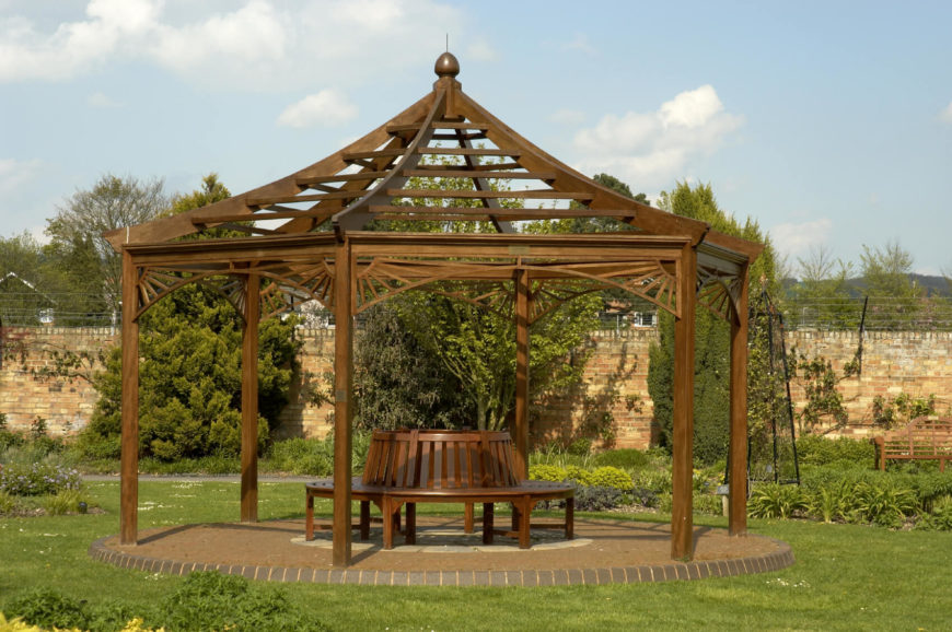 There is no better place for a bench than under a pavilion. It is a relaxing place to sit back and enjoy the gardens. This pavilion has a slatted roof which provides shade but still lets some sunlight through.