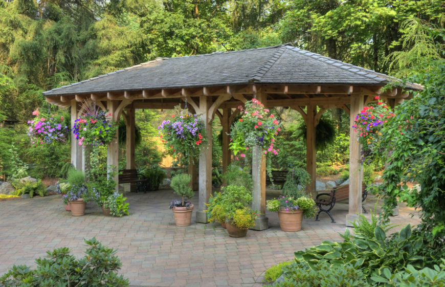 Pavilions are the perfect companion to gardens. Hanging flowers on the outside of a pavilion makes the structure blend into nature. This creates a superb shady place to sit and enjoy the outdoors.