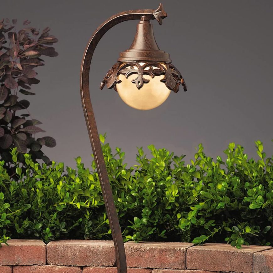 Here is another lantern with an iron look. This one has a bulb pointing downwards, providing focus and directing light to the plants underneath. No one will miss your spectacular garden with this lantern shining down on your plants.