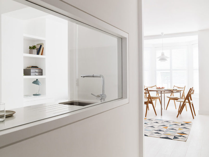 Moving back a bit, we see the large window that opens up the visual space between the entry and kitchen areas. This helps emphasize the space that is here, maximizing its impact.
