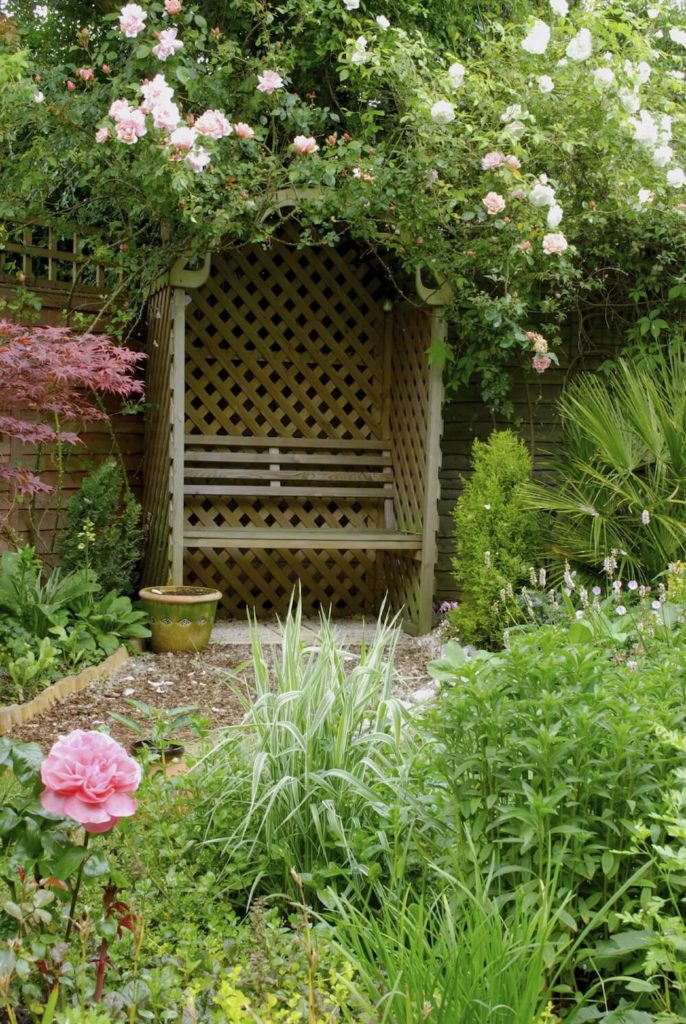 You can incorporate benches into other aspects of your yard. This lattice archway is a perfect place to put a bench. It makes this area feel a bit more enclosed and secluded.