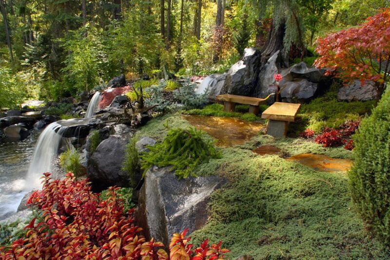 Benches can be very simple. All a bench really needs is an elevated, level surface that is suitable to sit on. Here are two very simple benches overlooking a lovely waterfall. This spot is the perfect place to get back to nature.