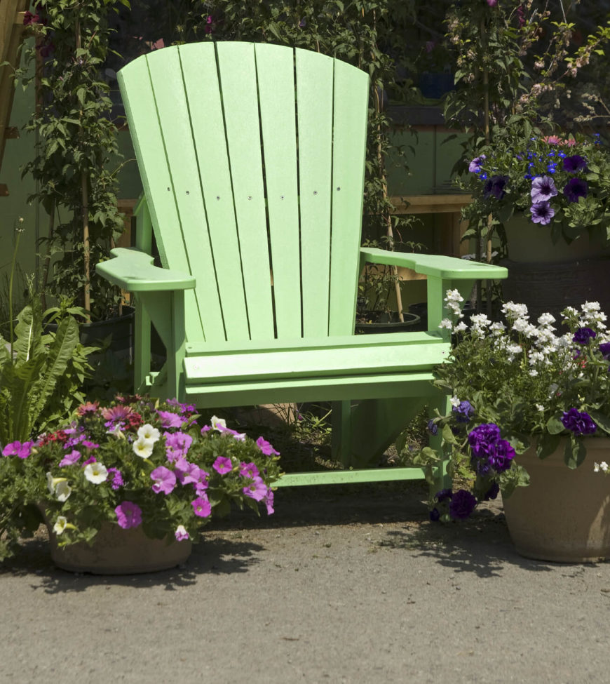 Here is a nice green Adirondack chair surrounded by potted plants. Even if your garden is not vast or your yard is not grand you can have a nice relaxing spot all to yourself. Use the room you do have to make your own personal getaway.