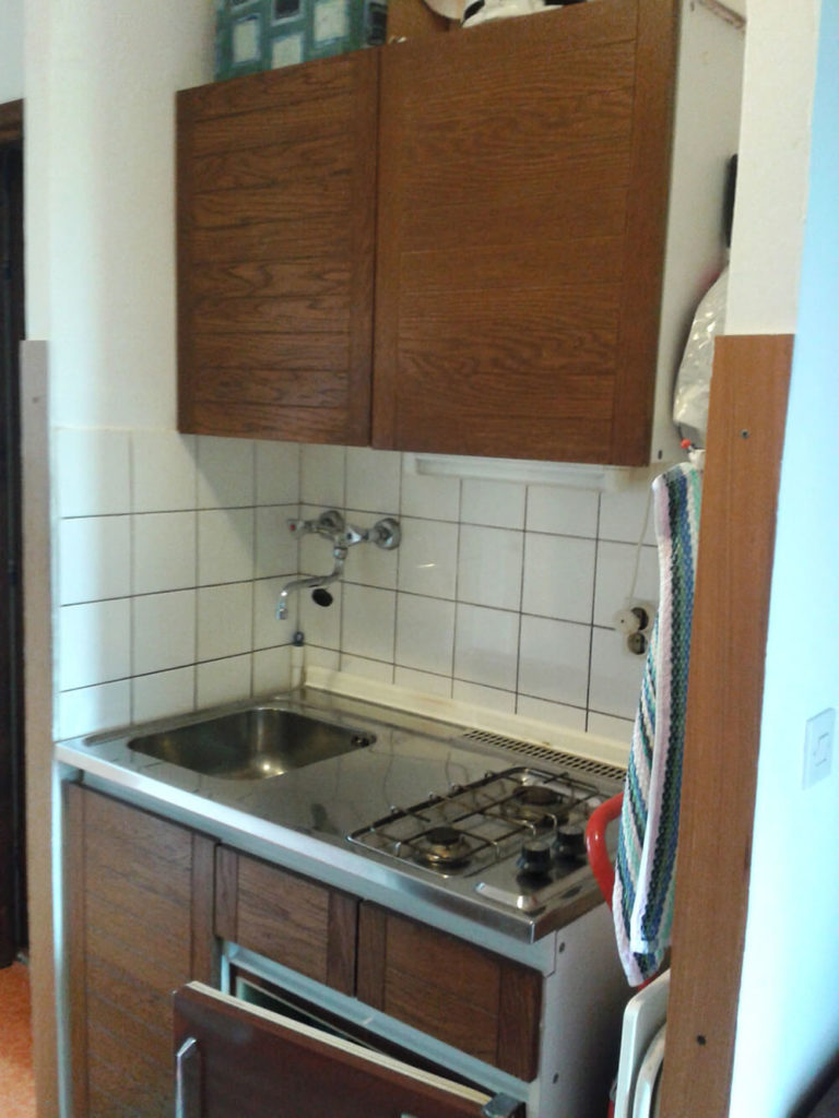 Before, the kitchen was so small that a sink and stove were crammed into a section in the hallway next to a living room.
