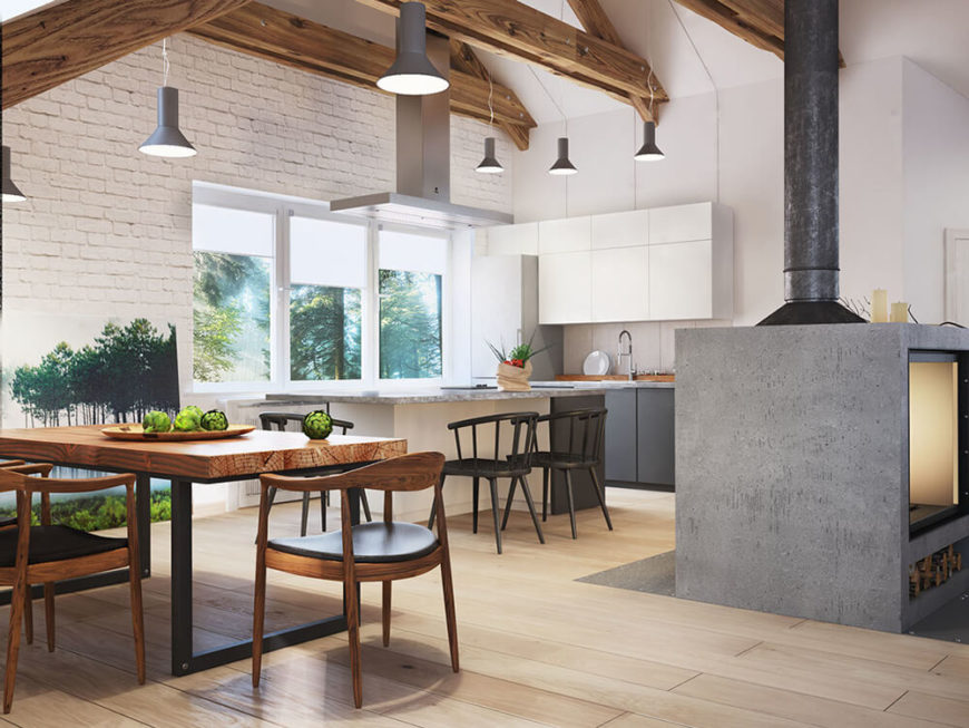The kitchen stands out with sleek white cabinetry and stone countertops, a cool color tone in contrast with the rich hardwood flooring all around. At left, the dining table appears in rich wood with a black metal frame.