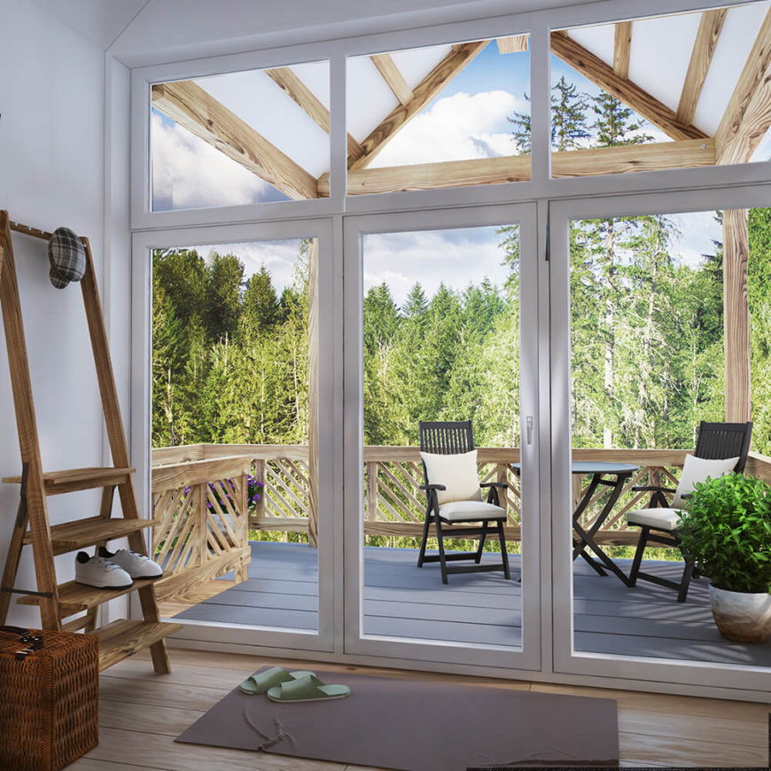 The home features a large patio for enjoying the outdoors. True to form, the large glass panel doors make this space almost one with the interior.