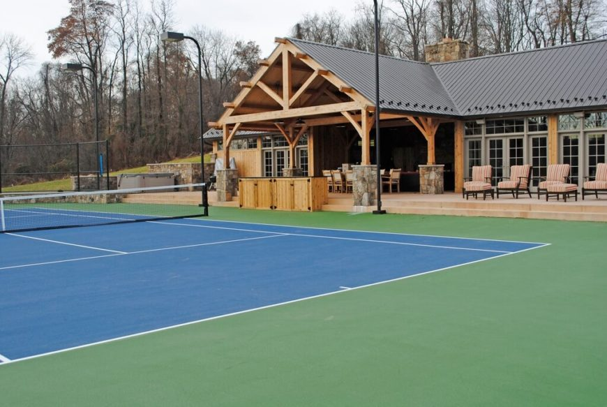 Here Is A Lovely Tennis Court With A High End Pavilion With Seating And  Glass Doors