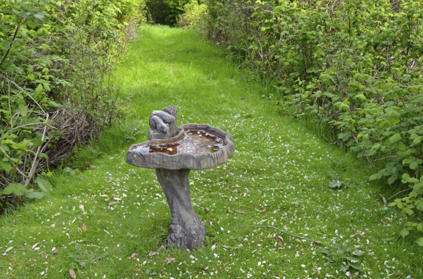 This resin bird bath is designed to look as if there is a critter on top about to jump into the water. These animal-inspired designs bring a sense of nature to the structure.