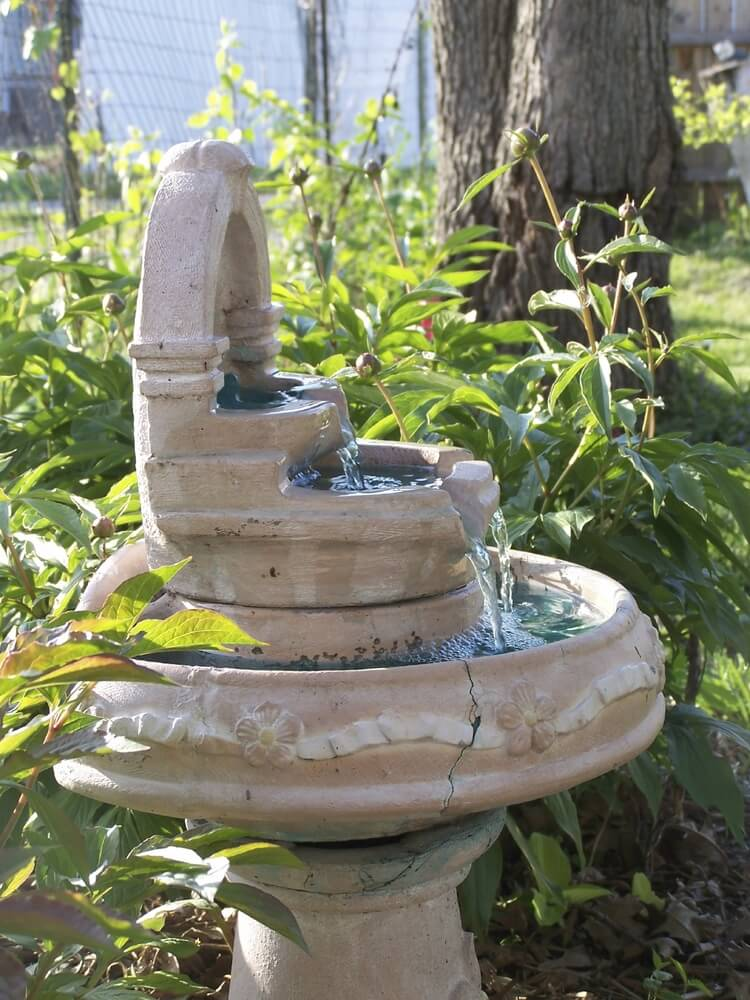 Here is a fountain and bird bath that has three tiers of basins for birds to splash around in. This is a wonderful vintage-looking fountain and bird bath that brings some extra class to any space.