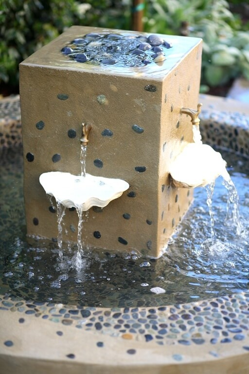 Here is a mixed material bird bath with nice ceramic components. The fountain additions keep the water circulating while the shell aspects disperse the falling water, giving the fountain interesting dynamics.