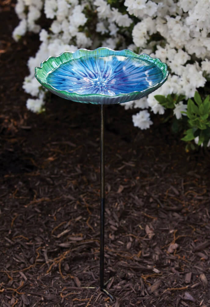 This glass bird bath looks like a large blue and green flower, adding to the motif and splashing extra color in your garden. However, this bath is on a thin stake which, if knocked over, could cause damage. So place it somewhere safe.