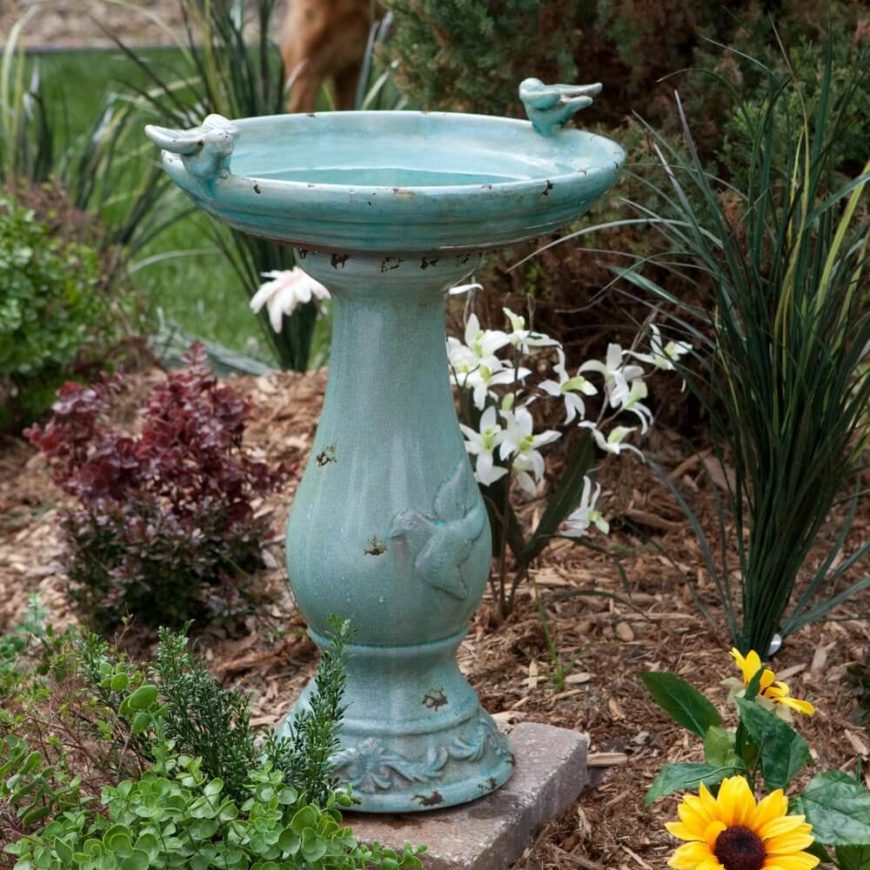 Here is a blue bird bath with a number of bird designs on it. This bird bath has an aged look which makes it fit in perfectly a number of rustic designs.