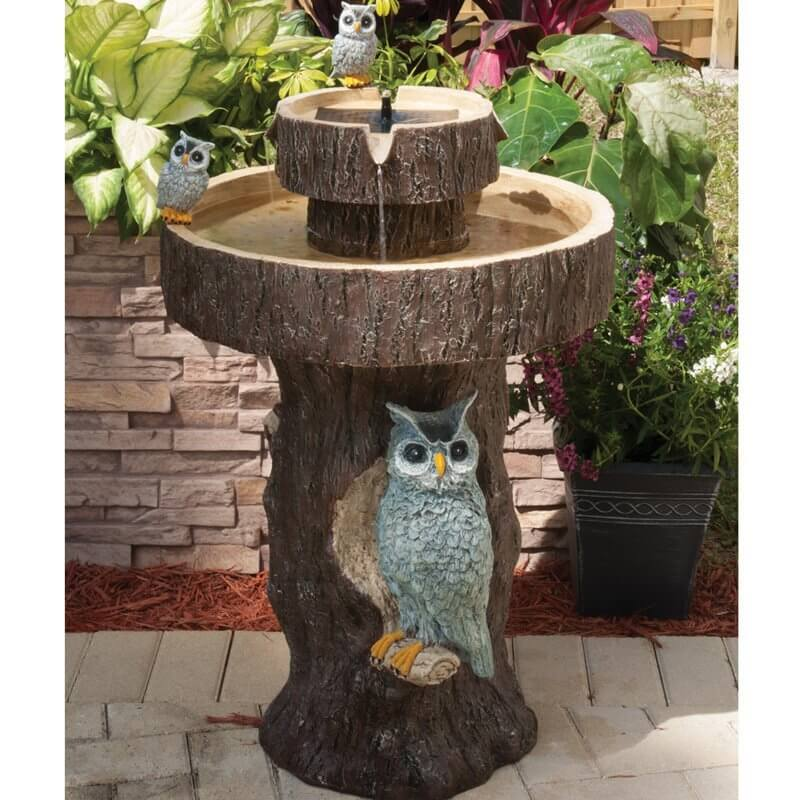 This birdbath is covered in owls. No matter the kinds of birds that visit this bird bath, they will surely be in good company.