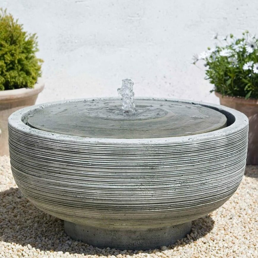 This large concrete bowl with a fountain in the center is a great place for birds to take a dip. It does not have a very deep basin, but not all birds need a deep place to dive. Some just want a place to get their beak wet.