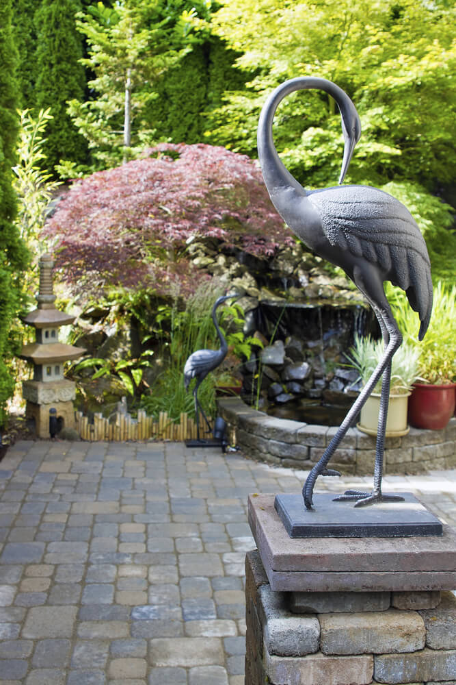 Many sculptures use natural shapes. These particular sculptures are in the shape of flamingos. The sculptures use the shapes and action lines of the flamingo to guide the observer's gaze through the space.