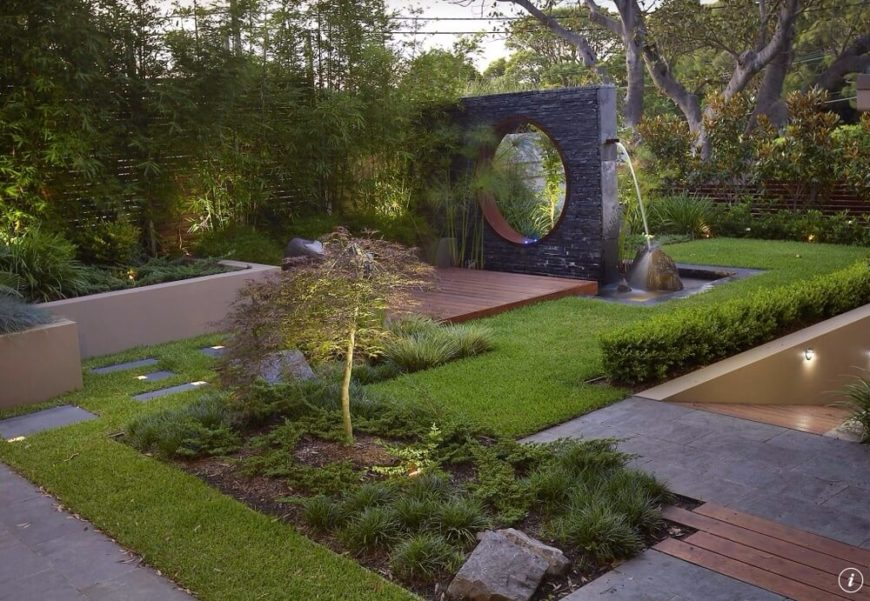 This sculpture is a large square with a circle cut through it. This is a very modern piece that has a very sleek and interesting appeal. This hardy and sturdy design can withstand the elements and remain a part of this landscape for a long time.
