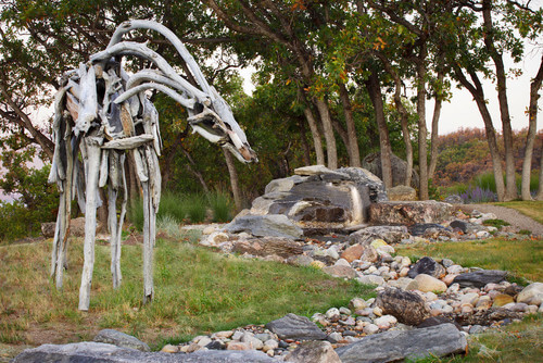 Sculptures come in various different materials. Many are made from stone, metal, or ceramic. This sculpture is constructed from found wood. This gives this sculpture a natural and rustic texture.