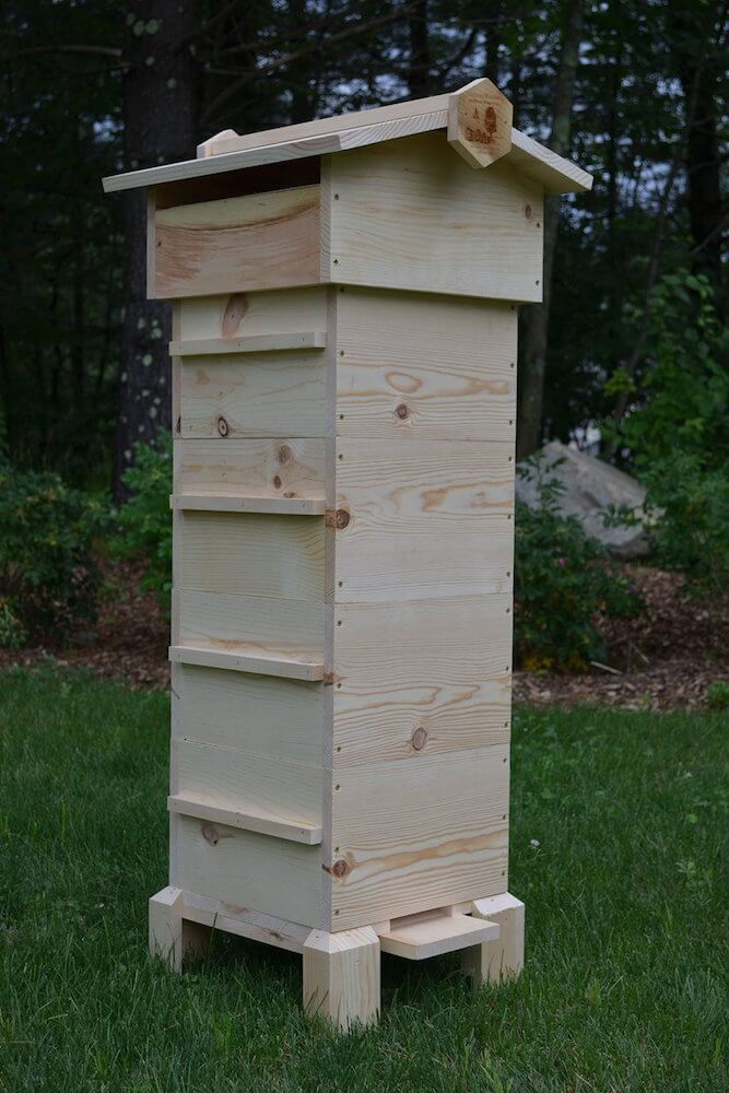 Our final bee house is the perfect way for you to observe your hives in relative safety and privacy, with observation windows built in. The natural wood construction is a handsome presence in any yard.