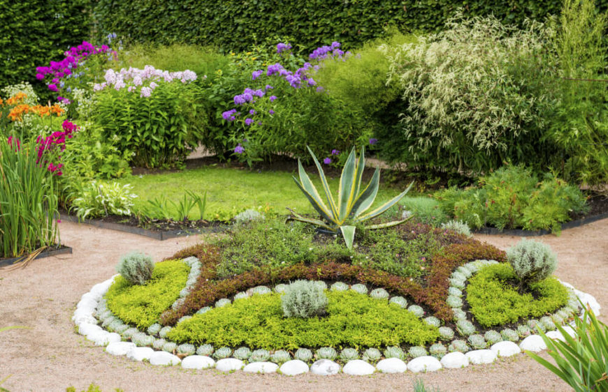 Here is a well designed and organized plant garden. Plant gardens such as this make a perfect centerpiece for a landscape. It is the perfect focus point for your yard and really heightens your design.