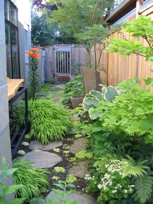 One of the great things about a varied plant garden is that you can let the plants grow wild and consume your area while still looking great. Moss and foliage look fantastic lining and covering stepping stones.
