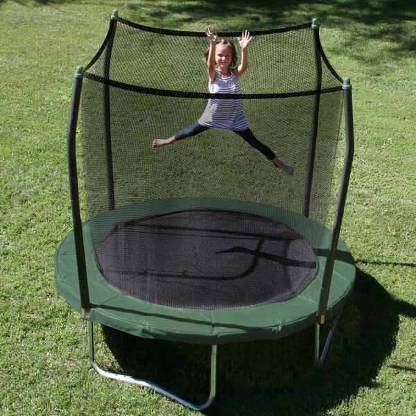 This smaller round trampoline is protected by a net fence. This kind of fence comes as a feature of many trampoline models and can help make the trampoline safer. They are designed to catch individuals before they are able to fall off of the trampoline.