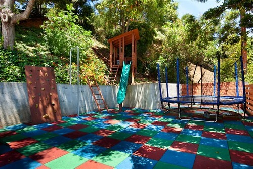 This space is the perfect play place for children. The ground in this outdoor space is padded, making it very kid friendly and the trampoline even safer. If someone does fall out of the trampoline net there is a soft padded floor rather than hard ground.
