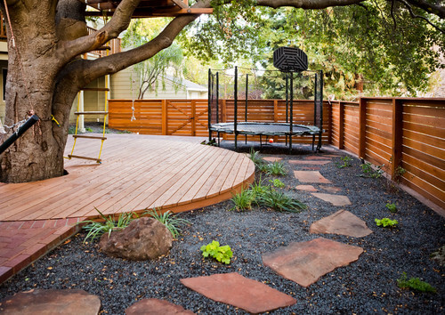 A basketball hoop is a great accessory to a trampoline. A hoop lets jumpers  on - 32 Fun Backyard Trampoline Ideas