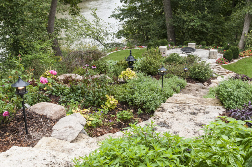 Some stones and lighting elements can give your large garden some extra appeal. Placing lampposts deep in a large garden is great because it puts the posts out of reach and illuminates a large area.