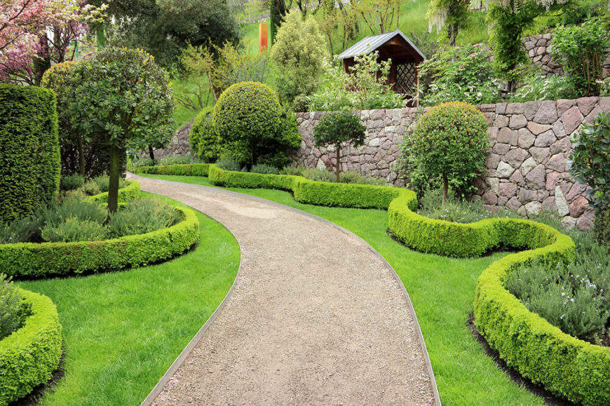 Hedges and trees pair perfectly to make a garden design. They can both be shaped and made to fit your design. This large garden of trees and shrubs makes a wonderful design to look at while you travel this path.