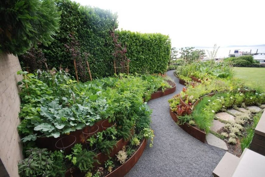 Stacked pots and raised garden beds can give your large garden depth and add dynamics. They can increase the appeal and cultivate a clean and organized look.
