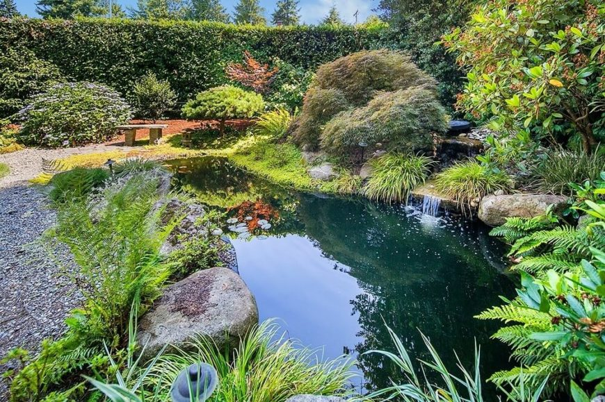 When you have a large and lush garden such as this you will likely want to enjoy it. A bench is a great addition to a large garden and pond area, making it a nice relaxing spot to enjoy the fruits of your labor.