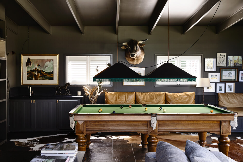 The black walls and dark finished tiles flooring make this room look so elegant. The classic billiards pool looks perfect with the room's style as well.