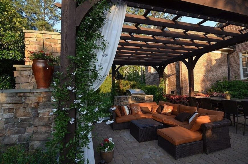 Vines can play well with other features as well. Here are some vines and curtains working together to bring class and elegance to the outdoor seating area.