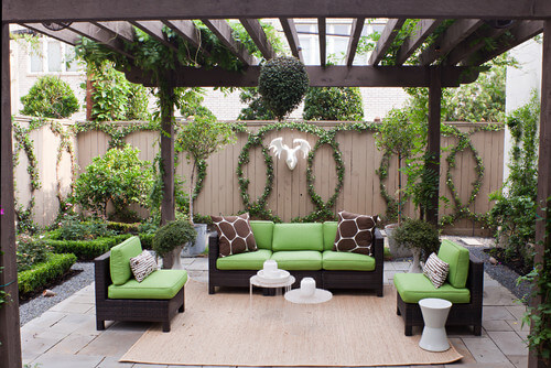 Here is a fence with an interesting circular vine design. There are a number of unique designs you can pull off with vines. Show off your creativity and your green thumb with a stunning vine design.